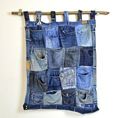 Full tutorial to upcycle and recycle your old jeans into this great looking and handy denim wall pocket organiser.