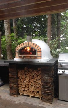 Authentic Handmade Brick Wood Fire Pizza Oven Pizzaioli This authentic wood-fired pizza oven makes any outdoor area come to life.