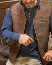 Even without the ingeniously hidden stash pocket for your handgun, this rugged sheepskin leather vest has plenty of attitude.