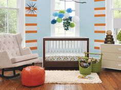 Aqua and orange paired with spring green makes for a playful, gender-neutral nursery palette that will remain appropriate as the child grows. Design by Susie Fougerousse