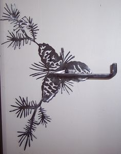 forged iron tp holder with pinecones- my newest obsession