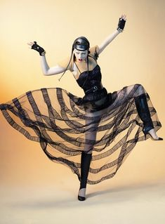 Coco Styled by Jean Paul Gaultier. Sheer striped black-on-black full skirt.