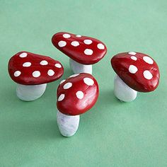 Simply adorable.  Painted rocks to look like mushrooms.
