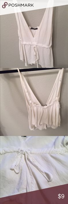 White low cut brandy tank top Frayed ends and tie in front lightly worn Brandy Melville Tops Tank Tops