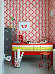 1970s 'Lavaliers' wallpaper from Little Greene creates a colorful backdrop for this workspace