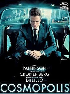 """""""Twilight"""" vampire Robert Pattinson is photographed sitting in a limo, wearing a slim black Gucci Signoria suit and a Chanel mens' watch, the J12 chromatic ceramic, titanium timepiece"""