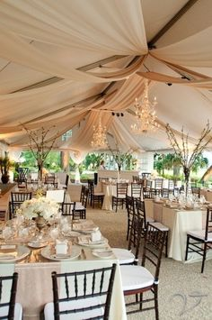 outdoor wedding reception-really like the center piece in lower left corner