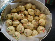 Italian Christmas Cookies 4 eggs 1 cup sugar 1/2 cup butter 2 tsp. vanilla 3 1/2 cup flour 4 tsp. baking powder Sift dry ingredients. Cream butter and sugar, beat in eggs; add vanilla and dry ingredients. Knead and add flour as needed to keep dough from sticking to hands. Pinch off dough, roll in your hands to form a log and then twirl into shape. Place on greased cookie sheets. Bake at 375 for 10 minutes. Icing 2 cup sifted confectioner's sugar 2 tsp. vanilla 6 tsp. water Stir until creamy…