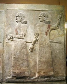 Two Assyrian officials from Khorsabad Palace, Court VIIIReign of Sargon II, 721-705 B.C.E. Excavated by the Oriental Institute, 1928-9 Gypsum (?), H: 308.0 cm, W: 249.7cm  Sometimes all you need to tell you a figure is a eunuch is a smooth face, as in this Assyrian relief.