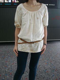 loose, light tunic, belt, & jeans