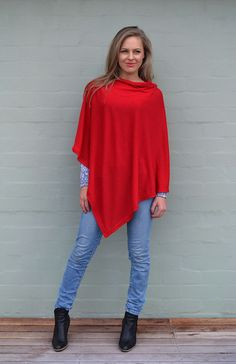 Classic Poncho  - one size fits all, it is beautifully lightweight 100% superfine merino wool, with a wide slit neck and you can wear it over anything! Great with jeans and boots - but dressy over a fitted smitten dress and leggings...and lots of colours to choose from!