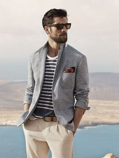 Shop this look for $199:  http://lookastic.com/men/looks/blazer-and-pocket-square-and-chinos-and-sunglasses-and-crew-neck-t-shirt-and-belt/2979  — Grey Cotton Blazer  — Brown Polka Dot Pocket Square  — Beige Chinos  — Dark Brown Sunglasses  — White and Navy Horizontal Striped Crew-neck T-shirt  — Tan Woven Canvas Belt