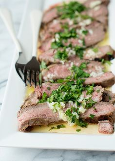 flank steak with garlic butter sauce recipe from @Bree Hester of Baked Bree