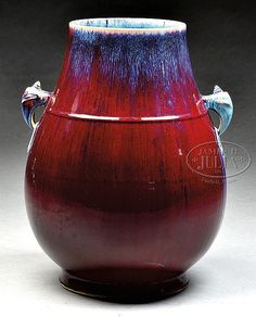 "LARGE PORCELAIN VASE. Late 19th century China. Pear shaped with morphic faux jump handles. Single bowstring mark at the shoulder. Red Lang Yao glaze with streaks of blue. Indescribable seal mark on the base. SIZE: 16"" Dia, 20"" h."