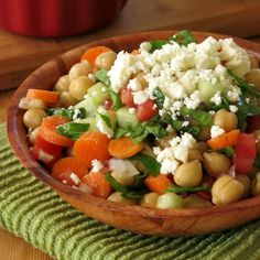 Chick Pea Salad marinates carrots, cucumbers, tomatoes, onion and spinach in a red wine vinegar dressing. The longer it sits, the better it gets!