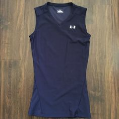 Under Armour Heat Gear Sleeveless Tank In navy. Barely worn. Great condition. Size small great for xs-S. It is compression so it's got some stretch to it. Under Armour Tops