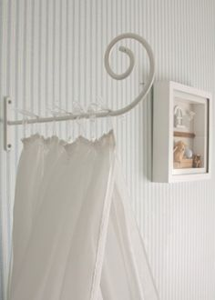 Baby room with striped wallpaper