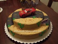 Homemade Lightening McQueen Birthday Cake: This Lightening McQueen Birthday Cake was done for a friend's son for his first birthday. His room is decorated in Disney Cars, so that's what his mother