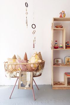 Vintage toys and crib at Achtung! Baby | a store in The Hague, the Netherlands | second-hand children's clothing and vintage wooden toys