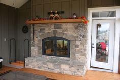 Accessories Exterior Attractive Home Interior Design Ideas Using See Through Fireplace Along With Fall Flower Mantel Decoration And Grey Stone Veneer Fireplace Surrounds Comely Home Interior And Livi Outdoor Wood Fireplace, Stone Veneer Fireplace, Wood Burning Fireplace Inserts, Indoor Outdoor Fireplaces, Stone Fireplace Surround, Outdoor Fireplace Designs, Fireplace Hearth, Modern Fireplace, Fireplace Ideas