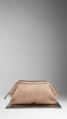 Burberry suede, leather clutch -- Tastefully exquisite.