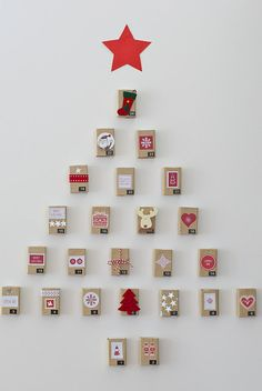 Very cute matchbox advent calendar. Cozy ♥...Cute idea to use for all sorts of things beyond Christmas..Snowflake shape..heart....
