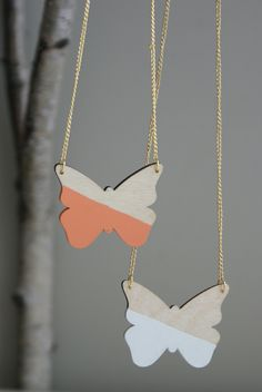 Wooden Butterfly Pendant Necklace Available in 6 colors. $18.00, via Etsy.