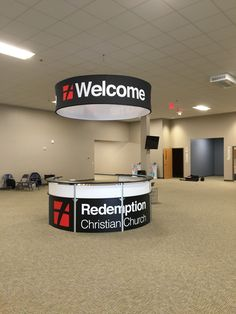 Redemption Christian Church in Jasper IN uses this Trade Show Display idea to create a Hospitality Desk and hanging signage that can be seen from any distance in the large room.