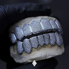 Custom White Gold Top And Bottom Grills Fully Iced Out. Specially made for Diamond Grillz, Diamond Teeth, Gold Diamond Earrings, Stylish Jewelry, Luxury Jewelry, Custom Jewelry, Fine Jewelry, Fashion Jewelry, Affordable Jewelry