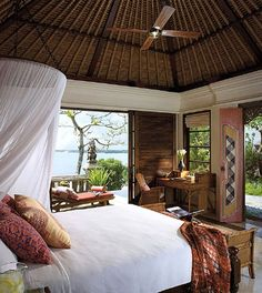 A Balinese inspired bedroom. This exquisite hotel suite is at the Four Seasons Resort Bali at Jimbaran Bay. Tropical Bedrooms, Tropical Houses, Tropical Gardens, Resort Bali, Bali Decor, British Colonial Style, Hotel Suites, Beautiful Bedrooms, Home Design