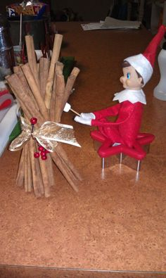 Elf on the Shelf - makeshift fire with our cinnamon sticks, so he could roast some marshmallows