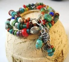 Triple wrap bracelet with antique African trade beads, turquoise, coral, jasper and many other gemstones. From Janet Miriam Designs on Etsy. by reva