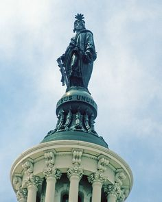 """The bronze statue """"Statue of Freedom"""" by Thomas Crawford on top of the Capitol dome, Washington, D.C. - Hmmm..."""