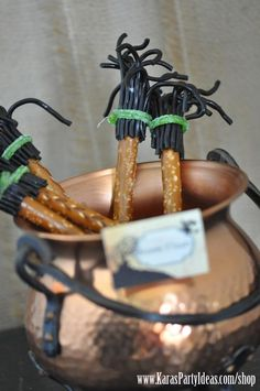 Halloween brooms made out of Pretzel sticks, black candy string & sour apple candy strips! Tutorial at #Kara's Party Ideas