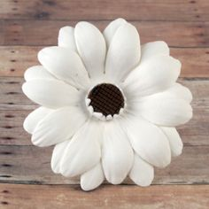 Daisies symbolize love, beauty, patience, and simplicity; and what better way to add simple beauty to your creations then these lovely readymade by hand gumpaste daisies. Gumpaste flowers offer a way