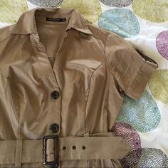 Perfect knee length button down khaki shirt dress! I really really wanted to love and keep it, but it's just a bit tighter than what I prefer. It's definitely slimming, but I want more room for my mommy body. Hits right at my knees, which is hard to find. Size 4. The Limited Dresses