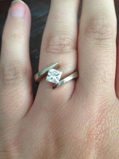 Simple My engagement ring I did randomly ask him so I actually got to pick this baby out A little over a carat princess cut tension set diamond style in