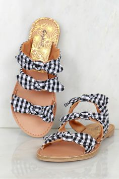 Triple Bow Gingham Slip On Sandals Black/White, A three-band slide sandal with a bow detail along each band featuring black and white gingham color blocking design and slight padding on the insole.