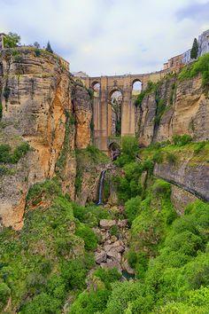 Ronda (Málaga) Three bridges, Puente Romano (Roman Bridge, also known as the Puente San Miguel), Puente Viejo (Old Bridge, also known as the Puente Árabe or Arab Bridge) and Puente Nuevo (New Bridge), span the canyon.