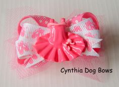 Boutique bows are a big look for your little furbaby and  will look so darn cute wearing them!Style: Boutique BowSize: 2-inchesAttachment: 2-Quality Latex Bands. If you prefer a French Barrette or Alligator clip, please upgrade using the selection box above.All my bows are thoughtfully...