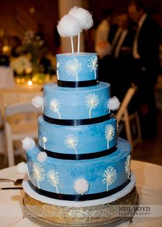 One of our favorite cakes!  Blue wedding cake with dandelion wish flowers.  | Raleigh, NC Weddings