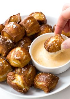 Homemade Pretzel Bites with a creamy cheddar cheese dipping sauce! Popable and super addicting these homemade pretzel bites will go fast! By chefsavvy.com