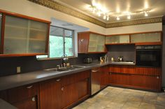 Other than the yucky border, the lighting, and the appliances, everything in this gorgeous kitchen is original. I almost had a heart attack when I walked in and saw the beautiful teak cabinetry and those pulls! To die for!     BeautifulThis is good