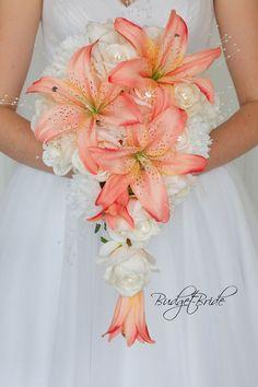 Peach Davids Bridal Wedding Flowers cascading lily bouquet coral diamond pins carnations pearls sticks teardrop shape Casablanca Lily