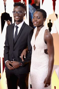 "celebritiesofcolor: ""Peter Nyong'o and actress Lupita Nyong'o attend the 87th Annual Academy Awards at Hollywood & Highland Center on February 22, 2015 in Hollywood, California """