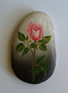 Beautiful rose painting on a stone