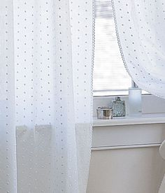 Swiss Dot Curtain. This is the quinessential bathroom window treatment, and here's why. It's a timeless classic. It's a bit old fashioned, but never stuffy. It's very affordable. It's opaque enough for privacy, but very translucent for letting in the maximum amount of natural light. I recommend simple panels, as opposed to fussy shirred valances. The fabric is sweet enough without added extra fluff!