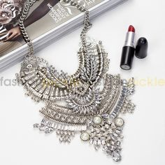 """""""Paris"""" The name says it all. This is an enchanting large silver necklace with a lot of personality and style. This is the only jewelry you would have to wear on an awesome night out or to any party."""