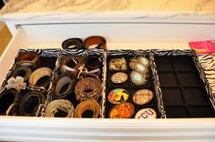 Organize belts and belt buckles in jewelry trays - Laura Piccolo Smith
