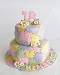 I have been wanting to make a patchwork cake for ages now and  I finally got a free hand in making a cake for  a friend's daughter for her 18th birthday! I thouroughly enjoyed making this cake! The bottom was  a 15cm hexegon shape and the top a 12,5 cm round! Fairly small cake but it did take me 5 hours to only do the patchwork!